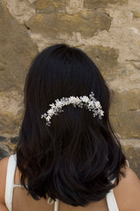 Silver Crystal Short Vine worn at the back of a models head with dark hair
