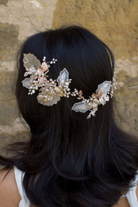 A dark haired model with hair down wears a Bridal Vine in Silver, Gold and Rose Gold
