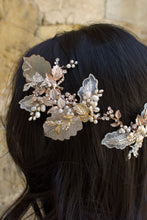 Load image into Gallery viewer, A dark haired model with hair down wears a Bridal Vine in Silver, Gold and Rose Gold with a background of a stones