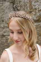 Load image into Gallery viewer, A Rose Gold Flowers and pearls wide tiara worn by a blonde bride with a stone wall background.
