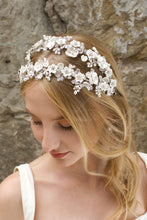 Load image into Gallery viewer, Blonde bride wears a double row flower headband with a stone wall background