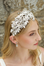 Load image into Gallery viewer, Blonde model wears a silver leaf headband thats wide she wears an earring and the background is a stone wall