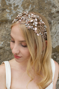 Rose Gold headband with clear stones worn by a bride