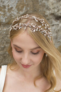 Double row pearl and rose gold headband worn by a blonde model