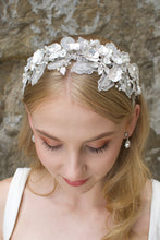 Load image into Gallery viewer, Lace Headband with white flowers worn by a blonde bride with a wall backdrop
