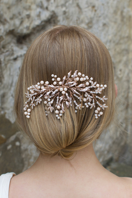 Pale Rose Gold Bridal Comb with Coral Swarovski Beads shown on a blonde hair Bride
