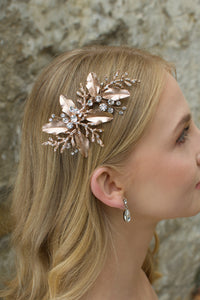 Rose gold leaves and twigs bridal side comb worn by a blonde model