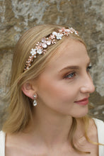Load image into Gallery viewer, Blonde Bride wearing a pale Rose Gold headband with flowers with a stone background