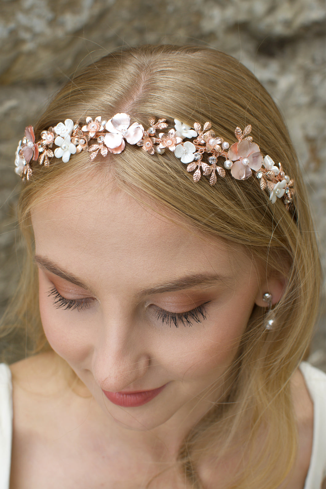 Blonde Bride wearing a pale rose gold headband with ceramic flowers