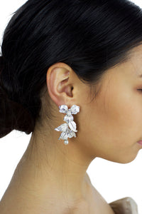 Silver Statement Bridal earring with flowers and white effect worn by a bride with dark hair