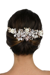 Pale Rose Gold Bridal Headpiece with ceramic flowers worn at the back of a models head with a white background