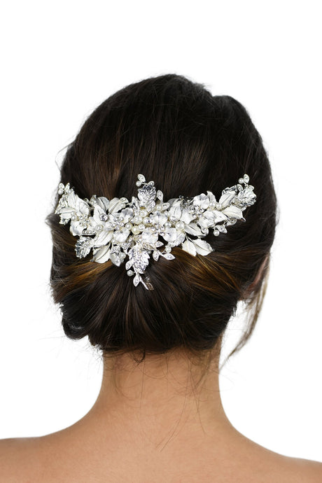 Silver leaves wide headpiece with pearls worn on the back of a dark hair model with a white background