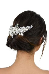Short Wide Silver Vine with leaves and pearls worn at the back of a models head with a white background