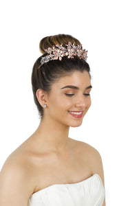 Rose Gold Flowers headpiece worn by a dark hair Bride with a white background