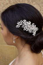 Load image into Gallery viewer, A model wears a silver and pear side comb on the side of her head.