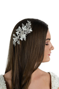Side view of brown hair model wearing a silver leaves clip for brides