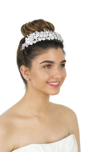 Smiling Bride wearing a Soft Silver Tiara with pearls with a white background