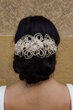 Load image into Gallery viewer, Bride wears a matt gold bridal comb on her dark hair in front of a stone wall