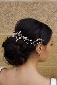 Side view of a Bridal Model with Pale Rose Gold Hair Vine with a stone background
