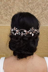 Pale Rose Gold Bridal Hair Vine on Dark Hair Model with a stone wall background
