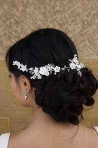 Silver Vine with porcelain flowers worn on the back of a brides head