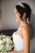 Load image into Gallery viewer, side view of a real bride wearing a silver leaf tiara holding a bouquet of flowers
