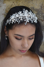 Load image into Gallery viewer, Wide headband in silver with white opal stones worn by a dark haired bride