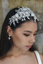 Load image into Gallery viewer, Silver wide headband with white opal stones worn by a model bride