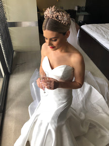 A beautiful real bride wearing a rose gold flower crown in her dressing room