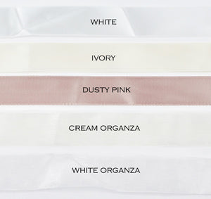 five different colours of satin ribbon on a white background