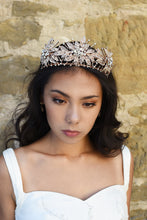 Load image into Gallery viewer, A handmade rose gold flower crown worn by a dark haired model