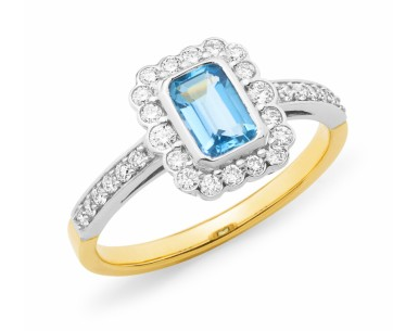 Aquamarine emerald cut with surrounding diamonds