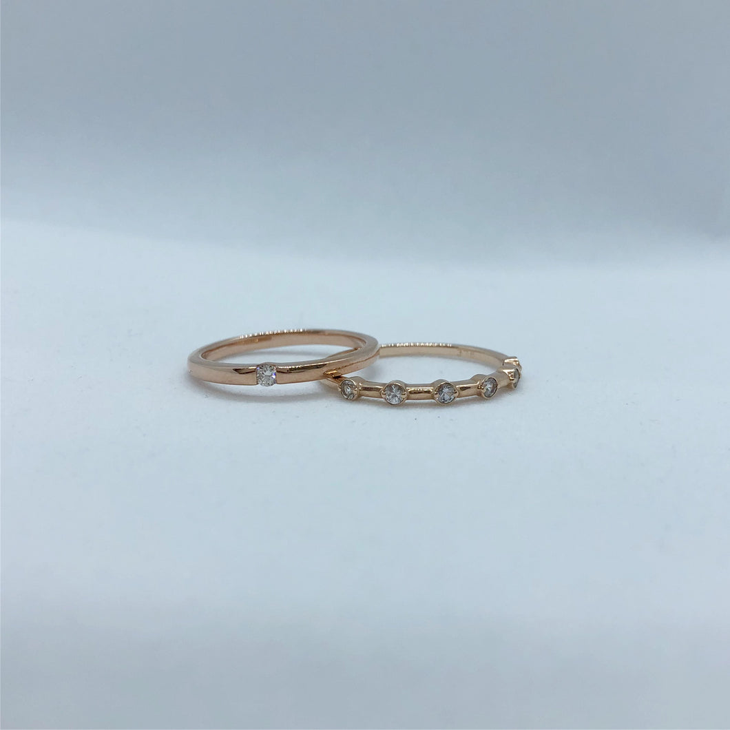 Dainty Design Rose Gold ring with suspended diamond