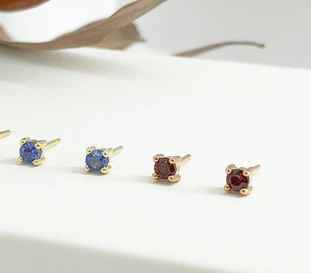 Rose Gold 4 claw studs with Garnet