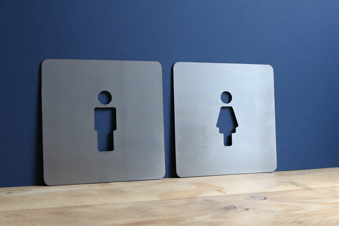 square man and woman toilet signs