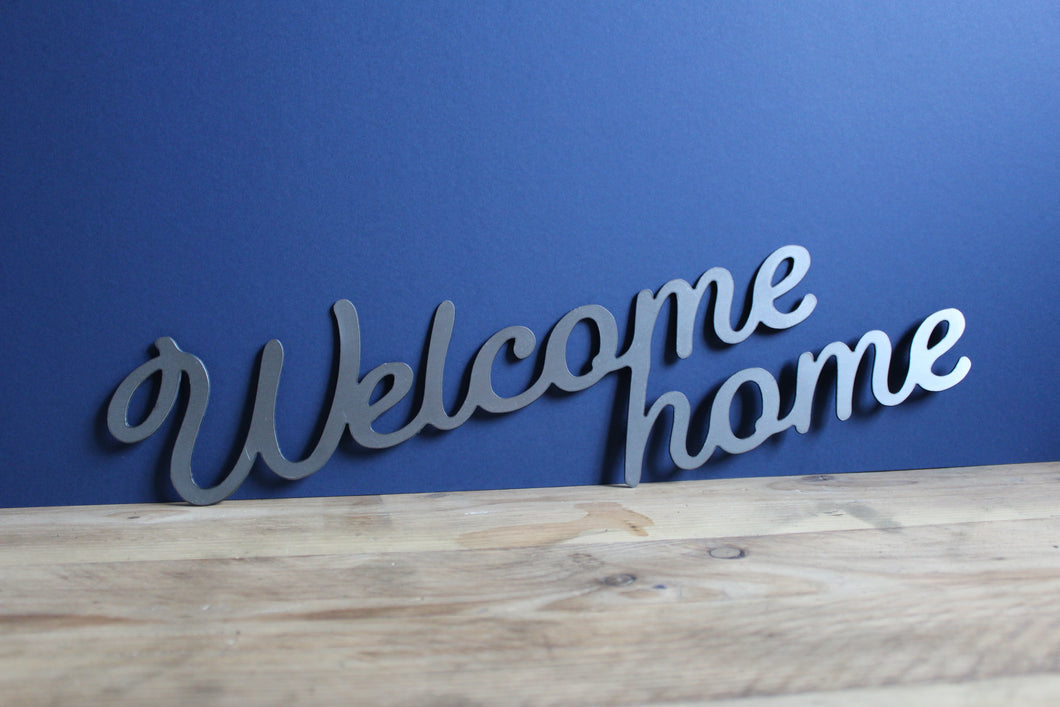 welcome home metal sign