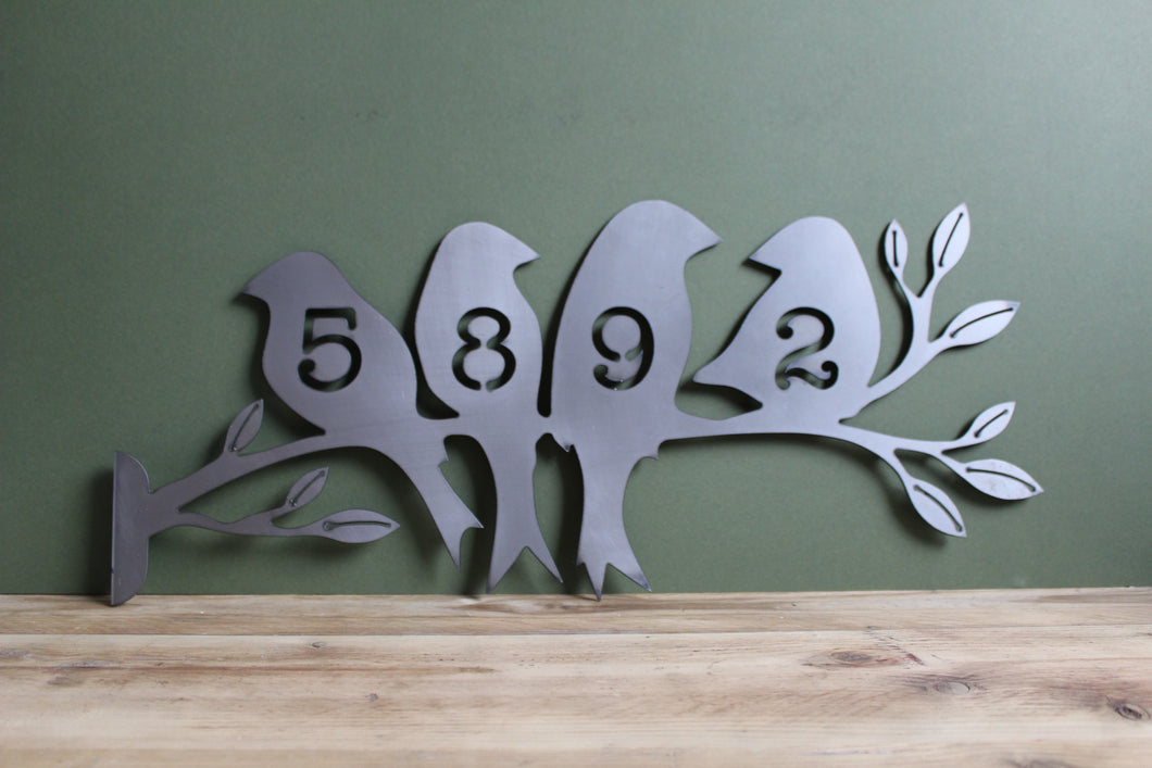 birds on a branch house sign