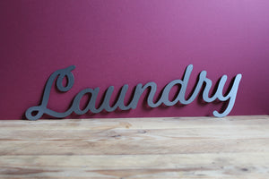 plasma cut metal laundry sign