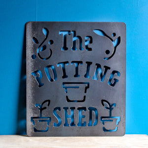 the potting shed metal sign