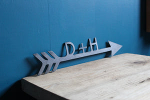 custom initial arrow sign