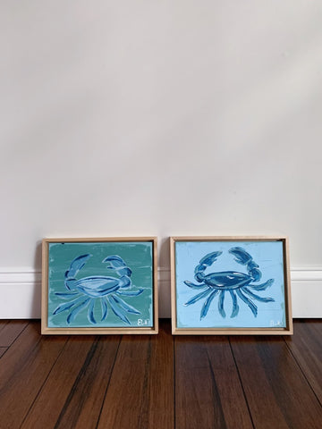 two acrylic crab paintings on canvas in a natural wood floating frame