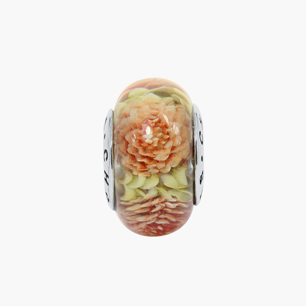 Small Dahlia Orange Green Amber Bead