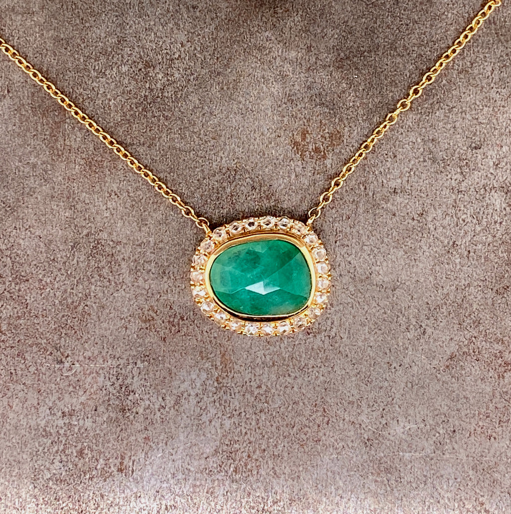 natural emerald pendant with diamond halo in 14k yellow gold necklace