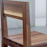 dark wood dining chair in walnut with square seat