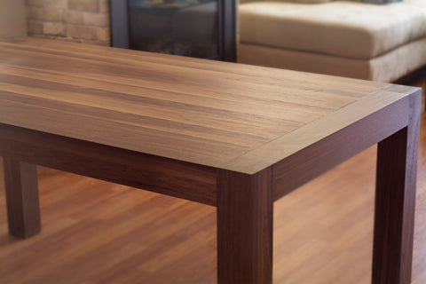 solid wood dining table in walnut wood with straight legs