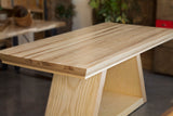 custom pedestal craftsman dining table with trapezoid legs