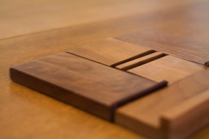 dark wooden iPad holder on desk laying flat