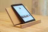 light wood holder on desk holding iPad