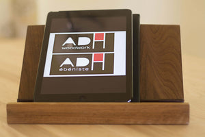 dark wooden holder on desk holding iPad