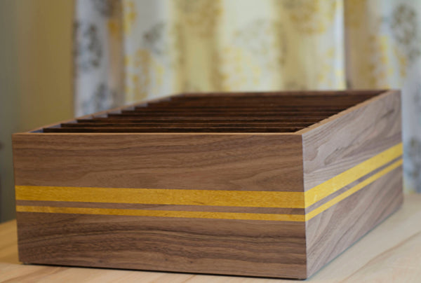 brown wood filing box with yellow stripe on desk